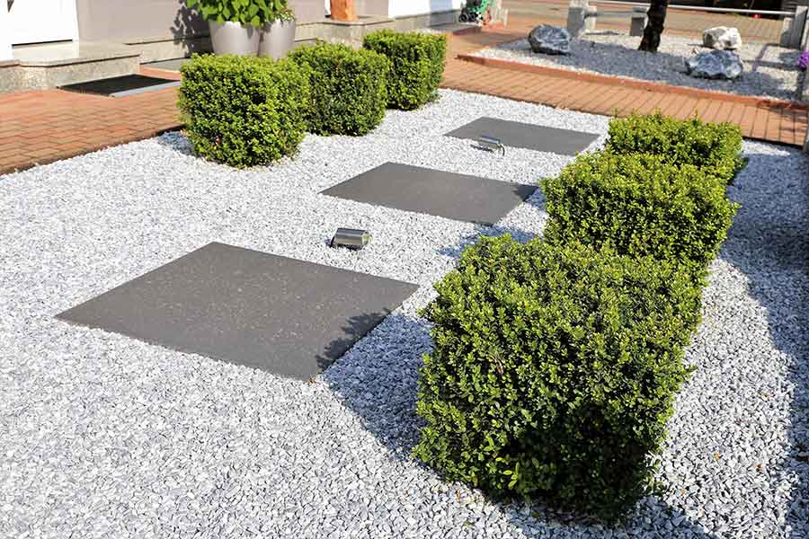 Decorative gravel used to soften hard landscaping and planting in a garden