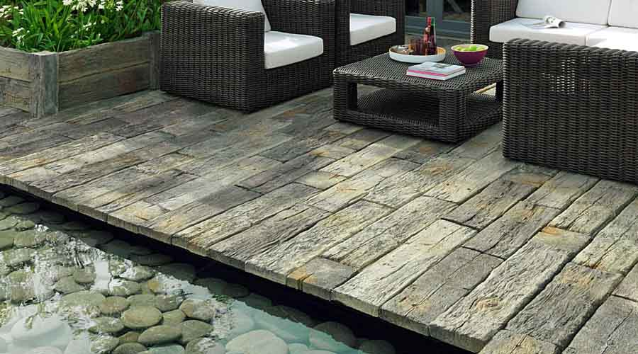 Paving stones and landscaping rocks for water features for Garden decking and slabs